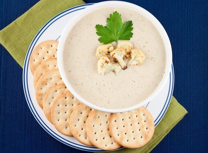 Roasted Cauliflower Soup Recipe : So Very Blessed – I am all about warm and cozy comfort food when the weather gets cold, and now definitely qualifies! Break out the hot tea, cozy blankets, warm sweaters, and all the SOUP. This delicious soup is packed full of roasted vegetables and it's creamy, but healthy, made without any cream! It's the perfect comfort food to warm you up on a cold winter evening.