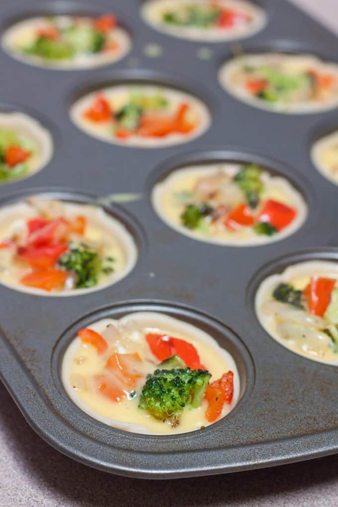 Roasted Vegetable Quiche Cups Recipe : So Very Blessed – Now that it is FREEZING in the morning when I wake up, I want a warm breakfast to motivate me out of bed. Oh, and also, I don't want to have to work hard for it. My brain doesn't work so well right after I wake up, which is why make ahead breakfasts save me. These easy and delicious veggie-packed quiche cups make for a warm and healthy breakfast, and are super convenient in their individual portion sizes! They are easy to grab in a hurry and they freeze great!
